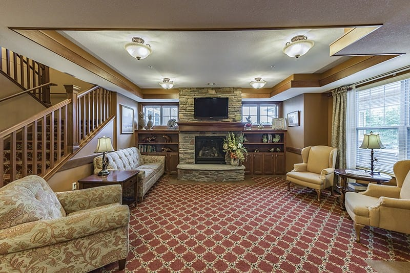 New Perspective Columbia Heights Sitting Room With Fireplace