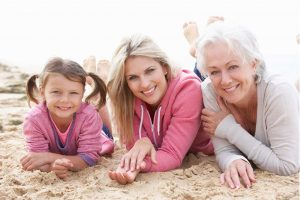 Senior Woman at the Beach With Daughter and Granddaughter