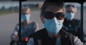 Masked Senior Wearing Sunglasses