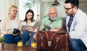 Doctors and Seniors Looking at Paperwork