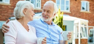 Senior Couple Drinking Coffee Outdoors